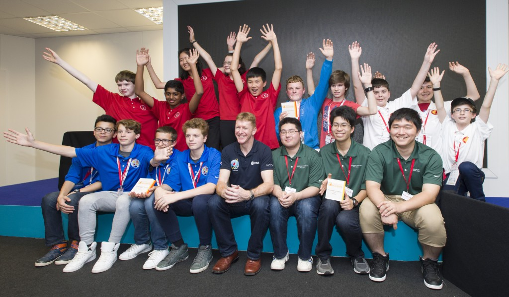 Raytheon, Farnborough Airshow 2016. TARC award ceremony Tim Peake British ESA astronaut, with 4 team who took part in the TARC rockety competition